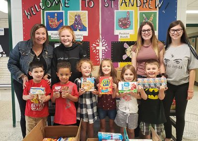 St. Andrew students pose in front of donated goods