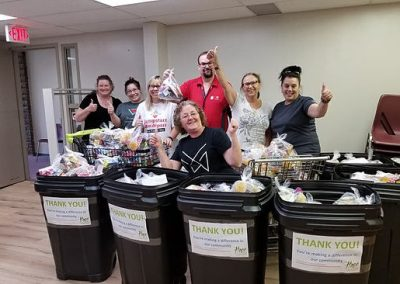 volunteers in front of collection bins