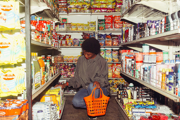 woman looking at pantry of non-perishable goods